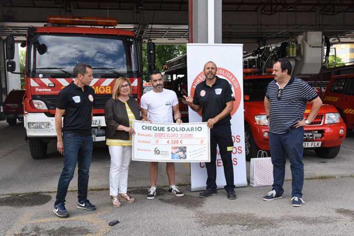 cheque bomberos solidarios para fibrosis quistica